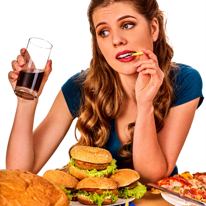 woman eating junk