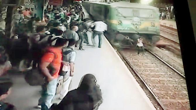 (The train hits her and knocks her over)