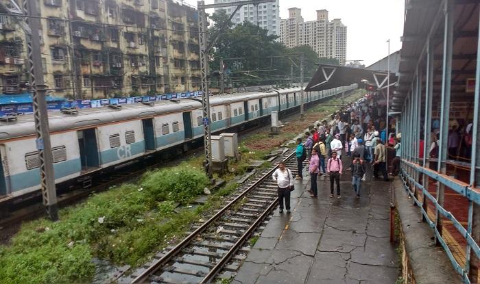 mumbai local train services resume  moderate rainfall