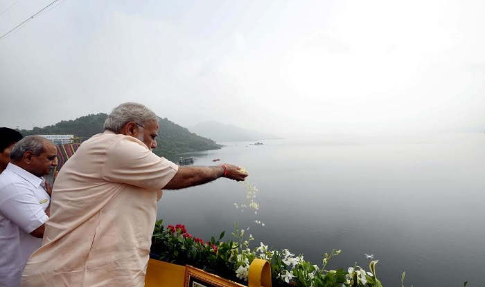 PM Modi paying tribute to the river Narmada before inaugurating the Sardar Sarovar Dam.