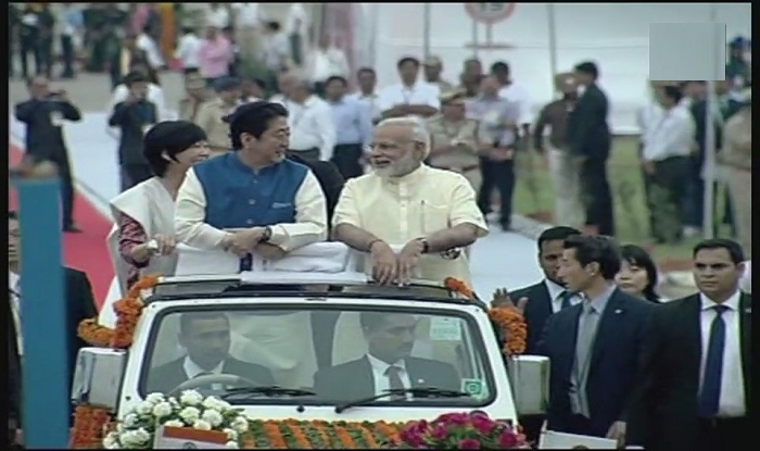 Pm Modi, PM Abe and his wife Akie Abe share a light moment on their way to Sabarmati.