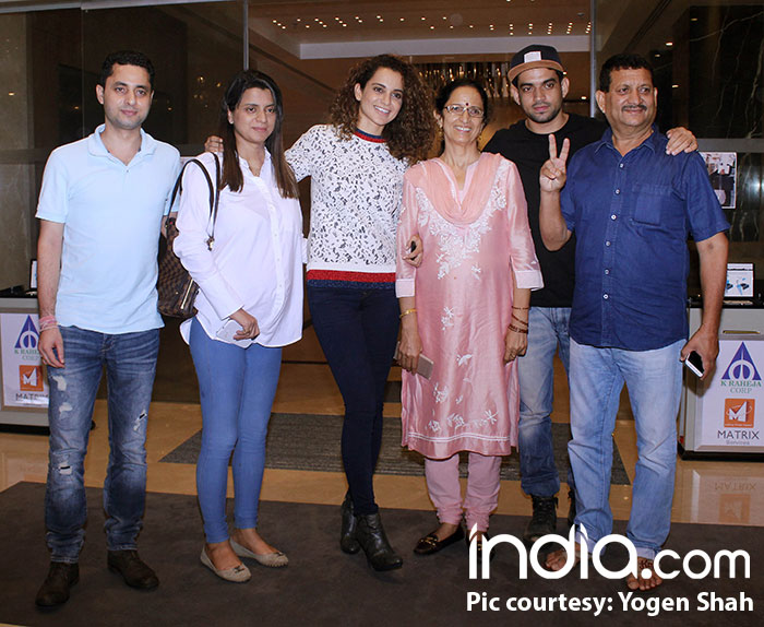 The Ranaut family is definitely all smiles as they pose for the shutterbugs