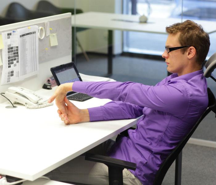 man stretchign at work 1