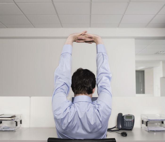 man stretchign at work 2