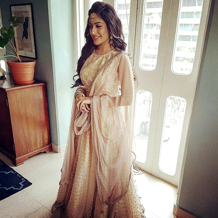 26bad3e06dd8b9 Slip into a cream-coloured lehenga and you can also add a dose of sexiness  to this dress with the crystal-encrusted under layers. Here, Surbhi Chandna  has ...