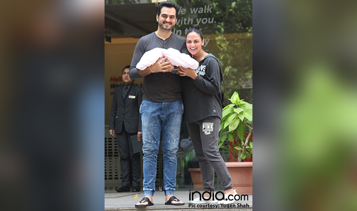 Esha Deol and Bharat Takhtani with their baby girl outside the hospital