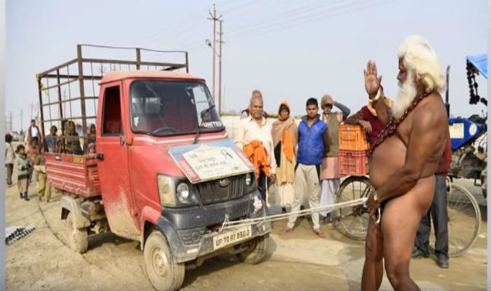 Tractor Going Right On Man : Magh mela photos of a baba pulling tractor with his penis