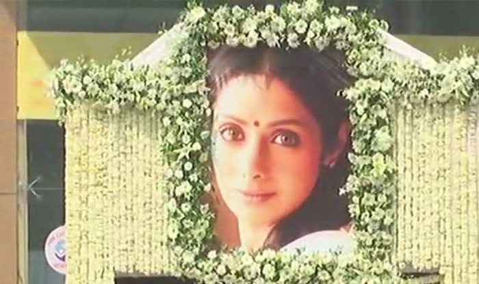 Sridevi was taken on her final journey on a truck decorated with flowers and a life size picture of her