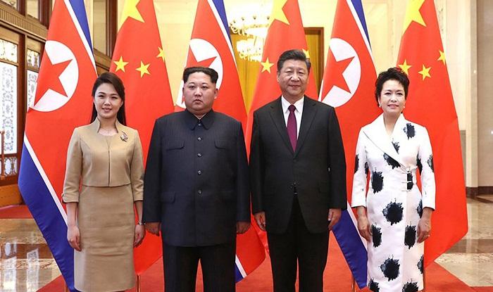 kim jong un meets xi jinping in china assures