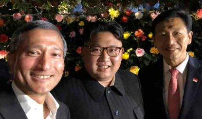 Kim jong walk in garden and take selfie before meeting with donald trump