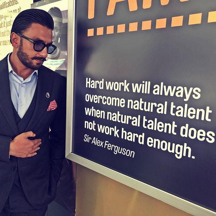 Ranveer Singh at Manchester United's stadium alongside quote of legendary coach Alex Fegurson