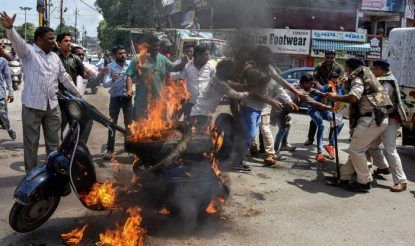 Congress party workers set a scooter on fire during Bharat Bandh in Jabalpur