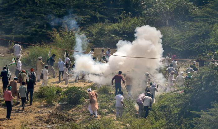 Police use tear gas to disperse farmers protesting at Delhi-UP border during Kisan Kranti Padyatra in New Delhi