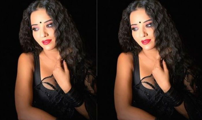 Bhojpuri Actor Monalisa Poses Seductively in Sexy Black Sheer Saree And Curly Hair