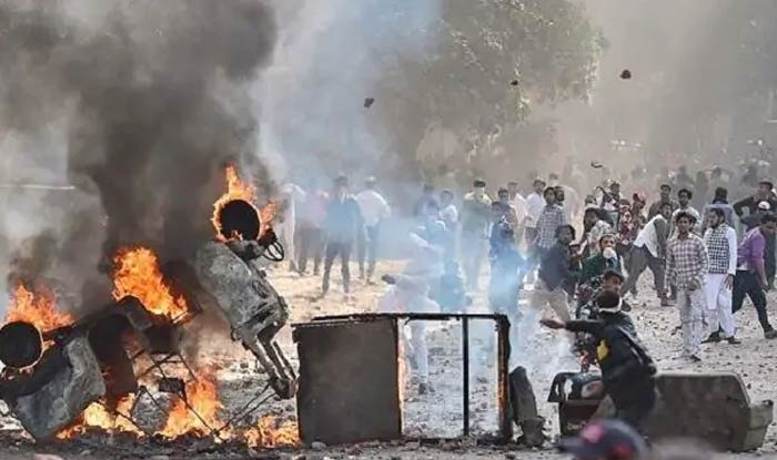 Delhi violence 27 year old arrested for alleged role in for Mohd shop