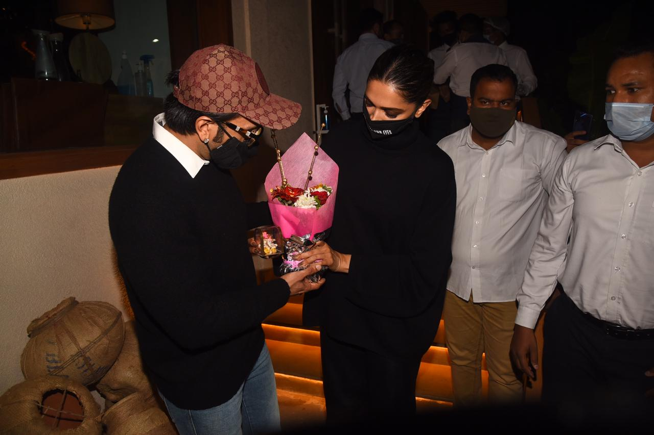 Deepika Padukone cuts cake with media