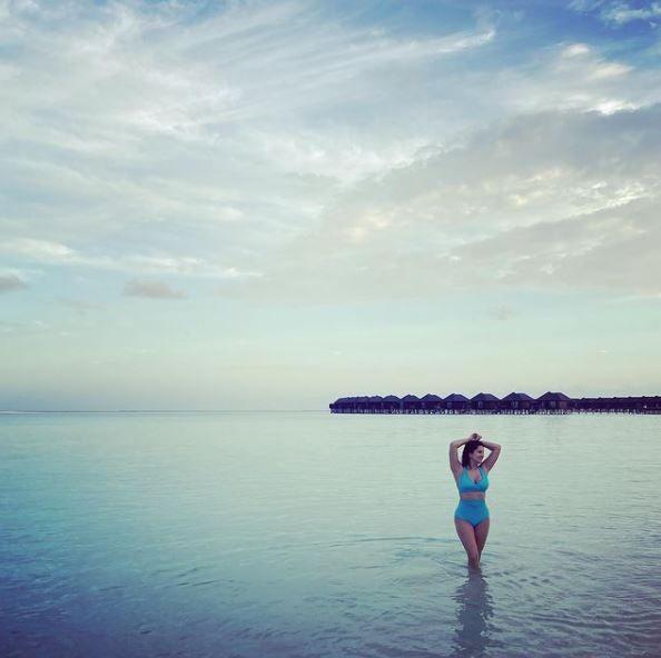 Sunny Leone Poses In Hot Blue Bikini as she vacays in the Maldives