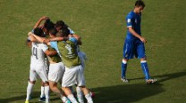 Uruguay boot Italy out of World Cup amid Luis Suarez biting storm