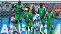 Lionel Messi double against Nigeria in 3-2 win ensures Argentina top group